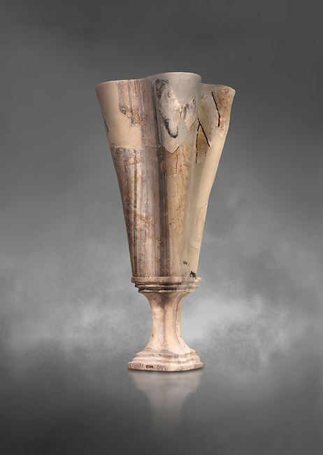 Minoan marble fluted chalice with fine four fold walls, Zakros central sanctuary complex 1500-1400 BC; Heraklion Archaeological  Museum, grey background.