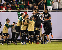 CHICAGO, IL - JULY 7: Mexican players celebrate a goal during a game between Mexico and USMNT at Soldier Field on July 7, 2019 in Chicago, Illinois.