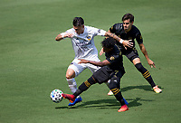LOS ANGELES, CA - AUGUST 22: Cristian Pavon #10  of the Los Angeles Galaxy battles with Latif Blessing #7 of of LAFC for a ball during a game between Los Angeles Galaxy and Los Angeles FC at Banc of California Stadium on August 22, 2020 in Los Angeles, California.