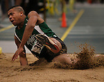 SPEARFISH, S.D. -- FEBRUARY 23, 2013 -- Carlton Lavong of Adams State lands in the pit in the men's triple jump Saturday during the 2013 RMAC Men's and Women's Track and Field Championships at the Donald Young Center on the campus of Black Hills State University.    (Photo by Richard Carlson/dakotapress.org)