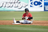 Romy Gonzalez (6) of the Kannapolis Intimidators sits on the ground after having been caught attempting to steal second base during the game against the Lexington Legends at Kannapolis Intimidators Stadium on May 15, 2019 in Kannapolis, North Carolina. The Legends defeated the Intimidators 4-2. (Brian Westerholt/Four Seam Images)