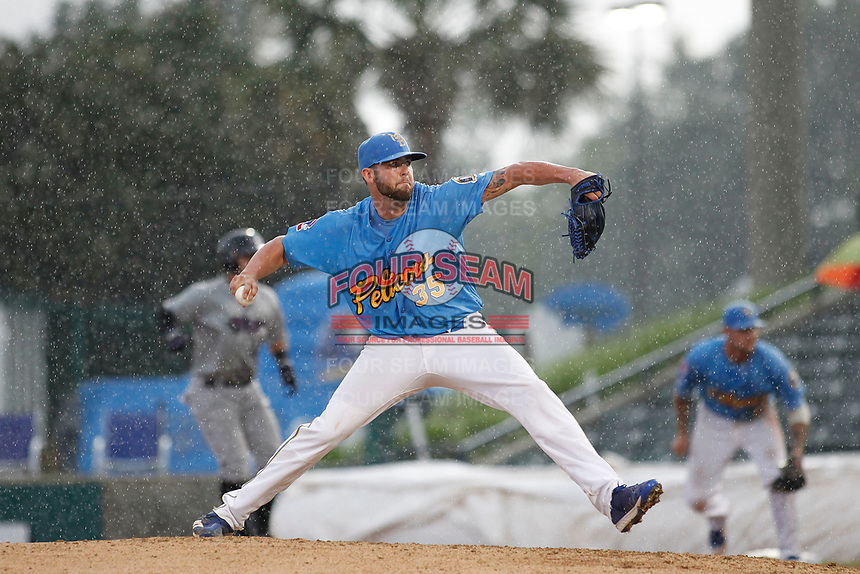 Myrtle Beach Pelicans pitcher Alex Lange (35) on the mound under a pouring rain during a game against the Winston-Salem Dash at Ticketreturn.com Field at Pelicans Ballpark on July 23, 2018 in Myrtle Beach, South Carolina. Winston-Salem defeated Myrtle Beach 6-1. (Robert Gurganus/Four Seam Images)