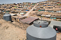 A large plastic water tanks, used for water storage, are seen on the dusty hillside of Pachacútec, a desert suburb of Lima, Peru, 20 January 2015. Although Latin America (as a whole) is blessed with an abundance of fresh water, having 20% of global water resources in the the Amazon Basin and the highest annual rainfall of any region in the world, an estimated 50-70 million Latin Americans (one-tenth of the continent's population) lack access to safe water and 100 million people have no access to any safe sanitation. Complicated geographical conditions (mainly on the Pacific coast), unregulated industrialization (causing environmental pollution) and massive urban poverty, combined with deep social inequality, have caused a severe water supply shortage in many Latin American regions.