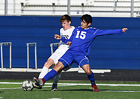 NWA Democrat-Gazette/CHARLIE KAIJO Rogers High School midfielder Andres Saldierna (15) blocks during a soccer game, Friday, April 26, 2019 at  Whitey Smith Stadium at Rogers High School in Rogers.