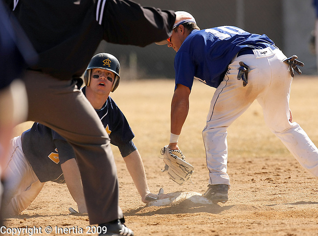 SIOUX FALLS, SD - MARCH 16:  Nate Baumann #23 of Augustana looks to the umpire after being forced out at second by Casey Gray #10 of the University of Mary during the first game of their doubleheader Monday afternoon at Ronken Field. (Photo by Dave Eggen/Inertia)