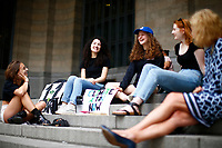 Leandra Mira, 17, protests for climate change on the steps  of the city county building with her friends Rachel Povloski (left), 20, Jacqueline LeKachman (blue hat), 18, Kate Schaughnessy, 19, as well as district 3 representative Anita Prizio (far right) downtown on Friday June 21, 2019 in Pittsburgh, Pennsylvania. (Photo by Jared Wickerham/Pittsburgh City Paper)