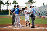 Bradenton Marauders coach Adam Godwin (41) during the lineup exchange with Pat Osborn (13) and umpires Emil Jimenez (left), Louie Krupa (right) before a game against the Tampa Tarpons on August 12, 2018 at LECOM Park in Bradenton, Florida.  The game was suspended in the bottom of the first inning due to weather.  (Mike Janes/Four Seam Images)