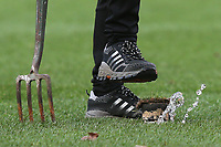 A Charlton groundsman presses his foot onto a sprinkler head to ensure its below the level of the turf during Charlton Athletic vs Barnsley, Sky Bet EFL Championship Football at The Valley on 1st February 2020