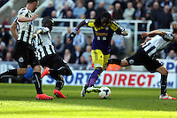 Pictured: Marvin Emnes of Swansea (C) on the attack, brought down by Cheik Tiote of Newcastle (2nd L) seconds before he was brought down in the box. Saturday 19 April 2014<br /> Re: Barclay's Premier League, Newcastle United v Swansea City FC at St James Park, Newcastle, UK.