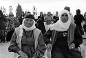 Turkey 2007 <br />At a wedding in Dogubayazit, old ladies sitting in armchairs with young women dancing in the background<br />Turkey 2007<br />Un mariage a Dogubayazit: Deux dames agées assises dans des fauteuils avec de jeunes femmes dansant a l'arriere plan