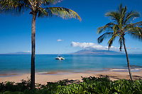 Sailboat heads out at Makena Beach, Maui, Hawaii.