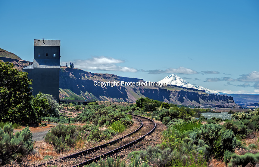 A mill and railroad long since out of use sit next to the Columbia River as it flows through the entrance to the gorge between the states of Oregon and Washington.