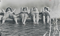 1967 FILE PHOTO - ARCHIVES -<br /> <br /> Cooling those 'Expo-Tired' feet. Just the way to cool off tired feet after a trip round Expo -dip them in a pool. From left Tom Brecshel; 12; Debra McConnell; 12; Ruth Haymer; 13; and Charles Kyle; 12; four of the 72-strong Star carriers who visited the fair as prize in circulation contest; really enjoyed themselves - and ended with a good old water fight.<br /> <br /> 1967<br /> <br /> PHOTO : Graham Bezant - Toronto Star Archives - AQP