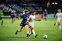 TACOMA, WA - JULY 31: Kaleigh Riehl #18 of Racing Louisville FC and Bethany Balcer #24 of the OL Reign battle for the ball during a game between Racing Louisville FC and OL Reign at Cheney Stadium on July 31, 2021 in Tacoma, Washington.