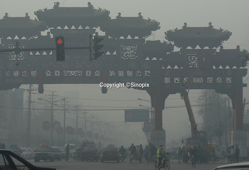 The city gate of Linfen City is shrouded in pollution at 11 am on a sunny day, Shanxi Province, China. Linfen is reportedly the most polluted city in China and at the heart of the coal mining industry. China produces around 2.4 billion tones of coal annually that contributes to more than 400,000 premature deaths annually due to air pollution, acid rain and poisonous ground water. It also contributes to global warming...PHOTO BY SINOPIX