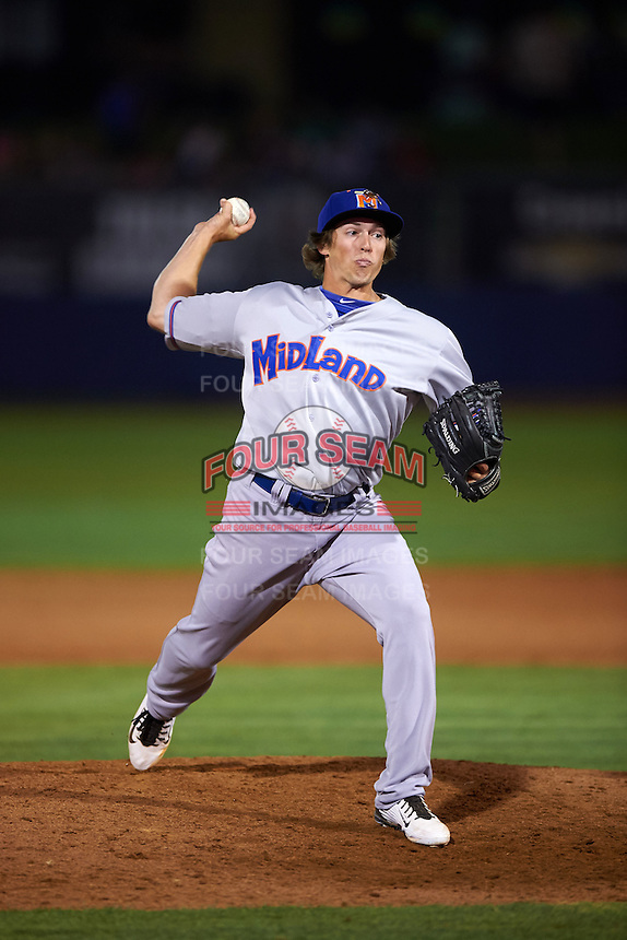 Midland RockHounds pitcher Ryan Dull (11) delivers a pitch during a game against the Tulsa Drillers on June 2, 2015 at Oneok Field in Tulsa, Oklahoma.  Midland defeated Tulsa 6-5.  (Mike Janes/Four Seam Images)