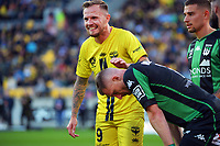 Wellington's David Ball jokes with Western United's Besart Berisha during the A-League football match between Wellington Phoenix and Western United FC at Sky Stadium in Wellington, New Zealand on Saturday, 22 May 2021. Photo: Dave Lintott / lintottphoto.co.nz