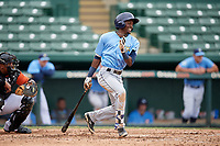 Tampa Bay Rays Vidal Brujan (2) follows through on a swing during an Instructional League game against the Baltimore Orioles on October 5, 2017 at Ed Smith Stadium in Sarasota, Florida.  (Mike Janes/Four Seam Images)