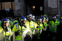 Police hold their line in front of demonstrators at the Bank of England as thousands of protestors descended on the City of London ahead of the G20 summit of world leaders to express anger at the economic crisis, which many blame on the excesses of capitalism.