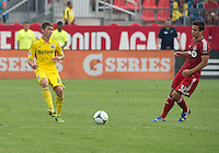 July 27, 2013: Toronto FC forward Andrew Wiedeman #32 and Columbus Crew midfielder Wil Trapp #20 in action during an MLS regular season game between the Columbus Crew and Toronto FC at BMO Field in Toronto, Ontario Canada.<br /> Toronto FC won 2-1.