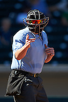 Umpire Sean Barber makes a call during an Arizona Fall League game between the Glendale Desert Dogs and Mesa Solar Sox on October 14, 2015 at Sloan Park in Mesa, Arizona.  Glendale defeated Mesa 7-6.  (Mike Janes/Four Seam Images)