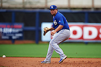 Dunedin Blue Jays first baseman Rowdy Tellez (8) fields a ground ball during a game against the Charlotte Stone Crabs on July 26, 2015 at Charlotte Sports Park in Port Charlotte, Florida.  Charlotte defeated Dunedin 2-1 in ten innings.  (Mike Janes/Four Seam Images)