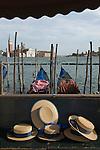 Venice Italy 2009. Gondoliers traditional straw sun hats. The church of San Giorgio Maggiore  from Saint Marks Square Piazza San Marco.