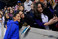 HOUSTON, TX - JANUARY 31: Christen Press #20 and fans of the United States celebrate with selfies during a game between Panama and USWNT at BBVA Stadium on January 31, 2020 in Houston, Texas.