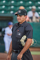 Umpire Edgar Suarez handles the calls behind the plate during the game between the Ogden Raptors and the Idaho Falls Chukars at Lindquist Field on July 2, 2018 in Ogden, Utah. The Raptors defeated the Chukars 11-7. (Stephen Smith/Four Seam Images)