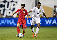 KANSAS CITY, KS - JUNE 26: Christian Pulisic #10 passes the ball after a challenge by Edgar Barcenas #10 during a game between Panama and USMNT at Children's Mercy Park on June 26, 2019 in Kansas City, Kansas.