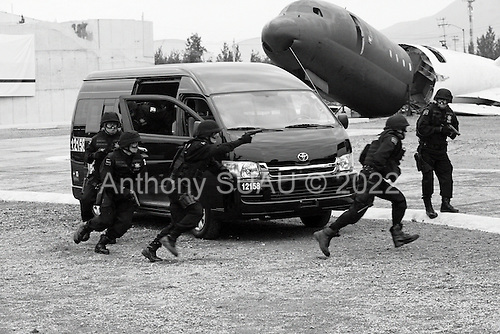 Mexico City, Mexico<br /> June 16, 2008<br /> <br /> Secretary of Public Security Genaro Garcia Luna, Mexico's President Felipe Calderon and Interior Minister Juan Camilo Mourino watch as a SWAT teams demonstrate their maneuvers at the opening of a new federal police center. The first of ten scheduled to open around the country.