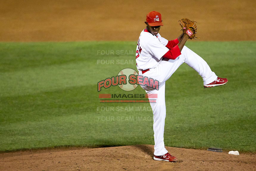 Samuel Freeman (12) of the Springfield Cardinals winds up during a game against the Tulsa Drillers at Hammons Field on July 19, 2011 in Springfield, Missouri. Tulsa defeated Springfield 17-11. (David Welker / Four Seam Images)