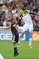Washington D.C. - March 8, 2014: Adam Bedell (29) of the Columbus Crew heads the ball against Luis Silva (11) of D.C. United. The Columbus Crew defeated D.C. United 3-0 during the opening game of the 2014 season at RFK Stadium.
