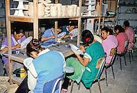 Ceramics, Nabeul, Tunisia.  Women Painting Designs on Ceramics.  Le Caravane Workshop.