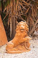 A lion statue in the garden. Prieure de St Jean de Bebian. Pezenas region. Languedoc. In the garden. France. Europe.