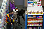 Shoppers wear face masks in a drug store in New York, U.S., on Thursday, March 19, 2020. New York state Governor Andrew Cuomo on Thursday ordered businesses to keep 75% of their workforce home as the number of coronavirus cases rises rapidly. Photograph by Michael Nagle/Redux
