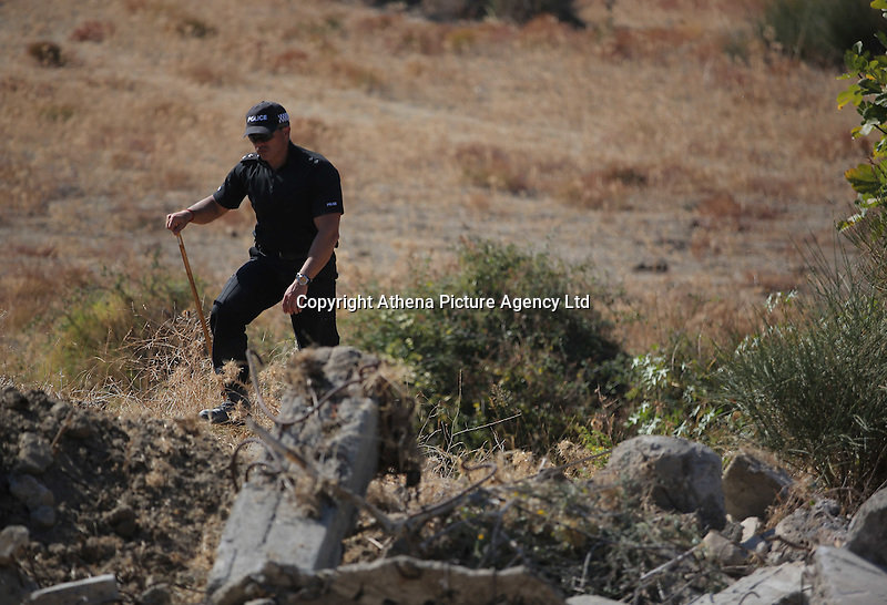 Pictured: A police officer involved with clearing the new site of the search, where rubble was deposited from the farmhouse where Ben Needham disappeared from in Kos, Greece. Thursday 06 October 2016<br />Re: Police teams led by South Yorkshire Police, searching for missing toddler Ben Needham on the Greek island of Kos have moved to a new area in the field they are searching.<br />Ben, from Sheffield, was 21 months old when he disappeared on 24 July 1991 during a family holiday.<br />Digging has begun at a new site after a fresh line of inquiry suggested he could have been crushed by a digger.