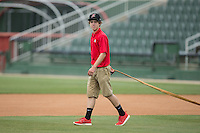 Allan Westerholt helps get the field ready for the South Atlantic League game between the Asheville Tourists and the Kannapolis Intimidators at Intimidators Stadium on May 28, 2016 in Kannapolis, North Carolina.  The Intimidators defeated the Tourists 5-4 in 10 innings.  (Brian Westerholt/Four Seam Images)