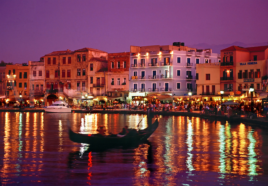Gondola old Venetian port at night with waterfront restaurants Chania Crete Greece