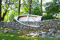 Funny repurposing of old boat in stone garden wall