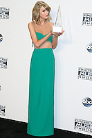 LOS ANGELES, CA, USA - NOVEMBER 23: Taylor Swift poses in the press room at the 2014 American Music Awards held at Nokia Theatre L.A. Live on November 23, 2014 in Los Angeles, California, United States. (Photo by Xavier Collin/Celebrity Monitor)