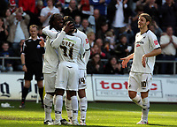 ATTENTION SPORTS PICTURE DESK<br /> Pictured: Jason Scotland of Swansea (L) celebrating with team mates after his successful goal from the penalty spot<br /> Re: Coca Cola Championship, Swansea City FC v Norwich City FC at the Liberty Stadium Swansea, south Wales. Saturday 11 April 2009.<br /> Picture by D Legakis Photography / Athena Picture Agency, Swansea 07815441513