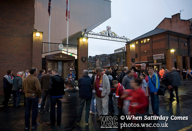 Liverpool 2 Northampton Town 2, 22/09/2010. Anfield, League Cup third round. Northampton Town and Liverpool fans standing next to the Hillsborough memorial outside the Shankly Gates at Anfield, before the team's Carling Cup third round tie away to Liverpool. The visitors from English League 2 defeated Premier League Liverpool on penalty kicks after a 2-2 draw after extra time in one of the biggest shock results in either clubs histories. Photo by Colin McPherson.