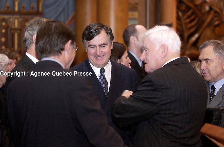 February 12, 2004 -  Lucien Bouchard, Yves Ryan attend the  Wake of Claude Ryan<br /> , former leader of the Liberal Party of Quebec, former editor, Le Devoir<br /> <br /> Archive - 12 fevrier 2004 - Le cerceuil  de Claude Ryan, ancien chef du PLQ et ancien redacteur en chef du Devoir, a la Basilique Notre-Dame