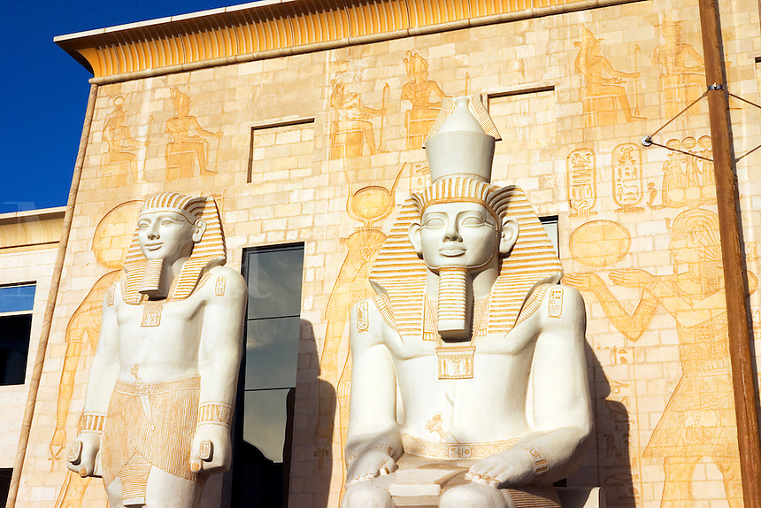 Dubai. United Arab Emirates.  Statues at the entrance to the Pyramids restaurant complex at the Wafi Centre/Center..