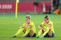 YOKOHAMA, JAPAN - AUGUST 6: Players of Sweden dejected and sad after their loss in the Final during a game between Canada and Sweden at International Stadium Yokohama on August 6, 2021 in Yokohama, Japan.