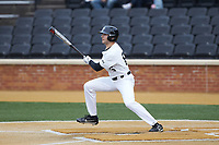 Michael Turconi (6) of the Wake Forest Demon Deacons follows through on his first collegiate hit during the game against the Sacred Heart Pioneers at David F. Couch Ballpark on February 15, 2019 in  Winston-Salem, North Carolina.  The Demon Deacons defeated the Pioneers 14-1. (Brian Westerholt/Four Seam Images)