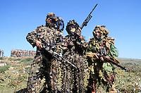 - sharpshooters camouflaged during a exercise at capoTeulada (Sardinia)....-  tiratori scelti mimetizzati durante una esercitazione a capo Teulada (Sardegna)