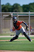 GCL Astros catcher Nerio Rodriguez (58) throws to first base during a Gulf Coast League game against the GCL Marlins on August 8, 2019 at the Roger Dean Chevrolet Stadium Complex in Jupiter, Florida.  GCL Astros defeated GCL Marlins 4-2.  (Mike Janes/Four Seam Images)