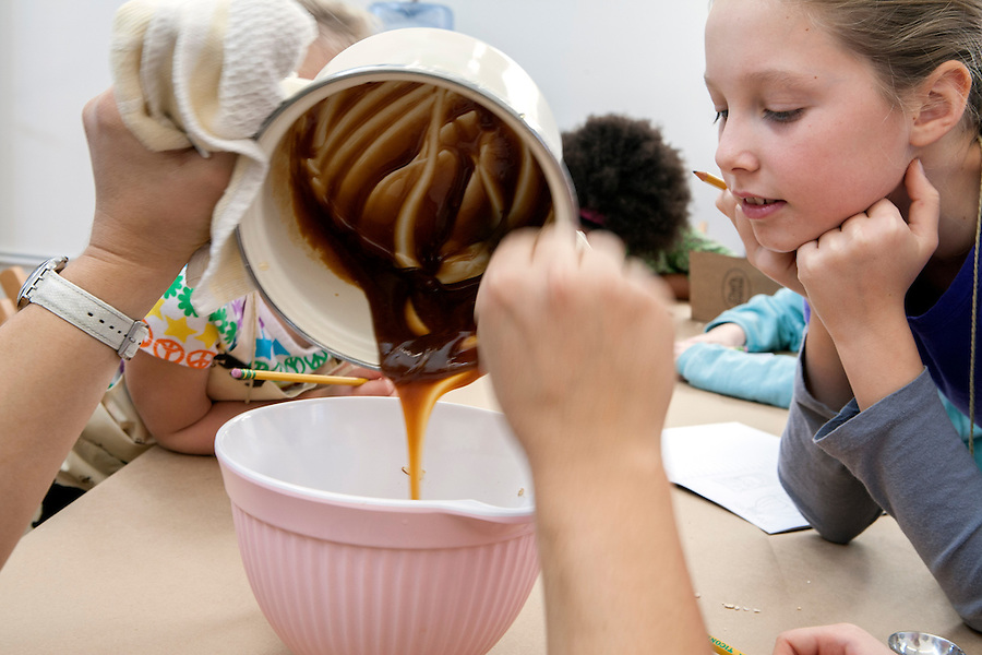 Young chefs create a meal during a cooking class for children taught by Skill It owner Leah Cherry. Located in Providence, RI, Skill It's mission is to teach and educate children about eating local, and sustainable practices.